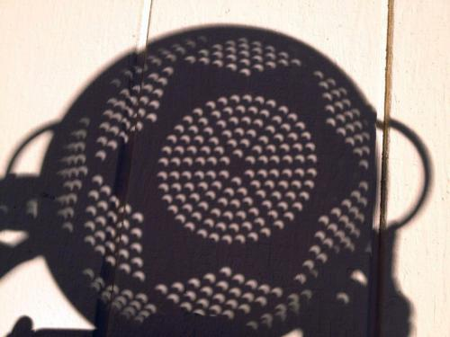 Catch the solar eclipse with a colander.