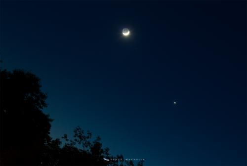 The crescent Moon and Venus in conjunction over Frosty Drew Observatory. Credit: Scott MacNeill