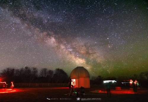 The Milky Way stretches over Frosty Drew Observatory.