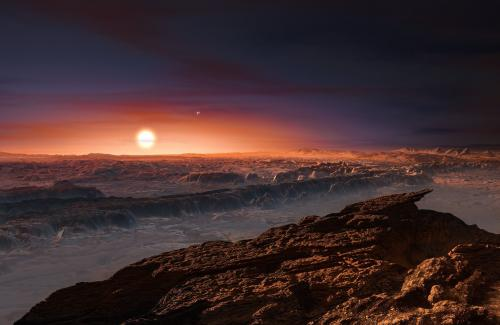An artists impression of Proxima b around the dim red dwarf star, Proxima Centauri. Credit: ESO/M. Kornmesser