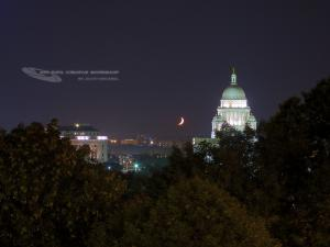 Crescent Moon setting over Providence, RI. Photograph by: Scott MacNeill